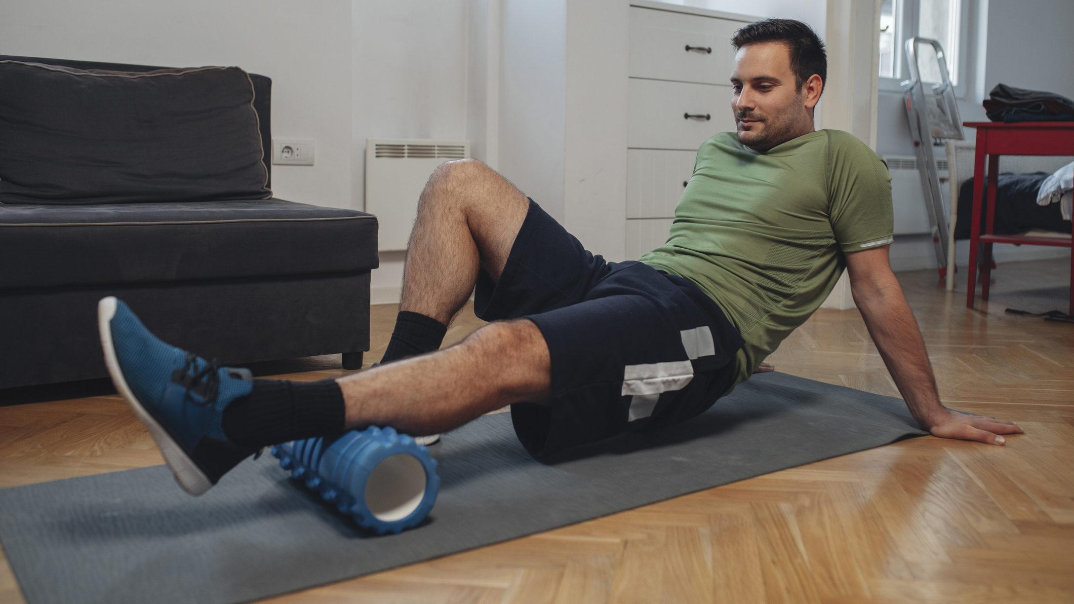 Man using foam roller to address musculoskeletal pain