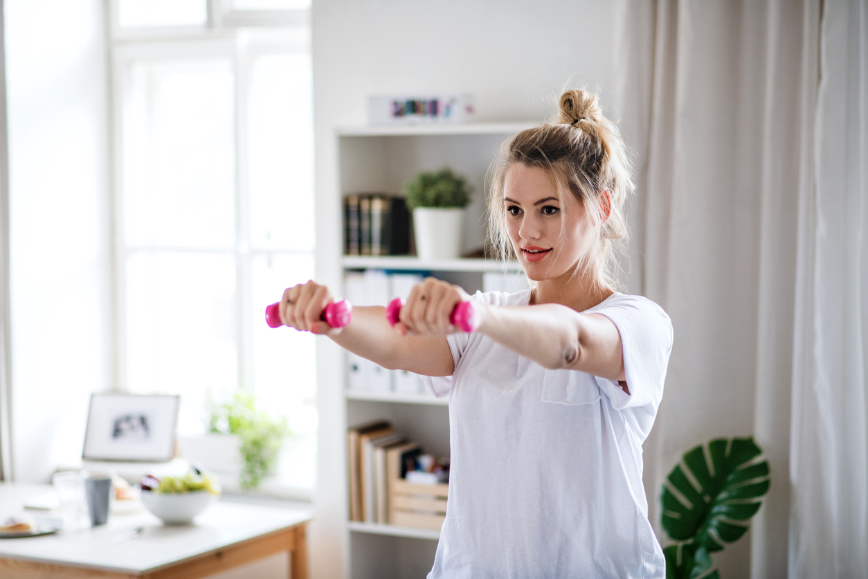 woman doing physical therapy exercises at home